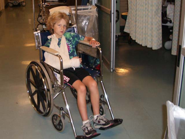 Jakob in wheelchair with broken arm